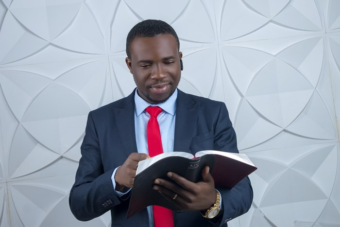Pastor Ogechi holding the bible